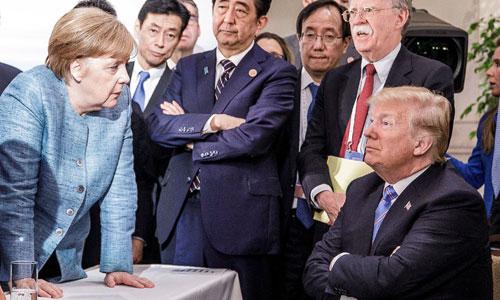 Bức ảnh thể hiệnthế đối đầu giữa Trump và các lãnh đạo G7 trong hội nghị đầu tháng 6. Ảnh: Reuters.