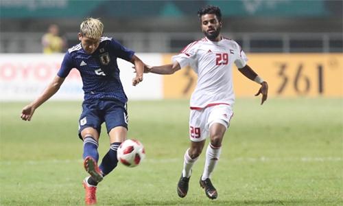 Đội bóng UAE (áo trắng) thi đấu với đội Nhật Bản ở Asiad ngày 29/8. Ảnh: Đức Đồng.