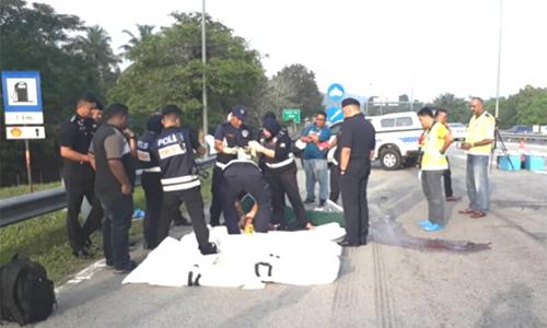 Cảnh sát Malaysia tại hiện trường vụ nổ súng. Ảnh: NST