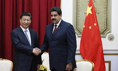 Chủ tịch Trung Quốc Tập Cận Bình (trái) và Tổng thống Venezuela Nicolas Maduro tại Bắc Kinh ngà y 14/9. Ảnh:Reuters.