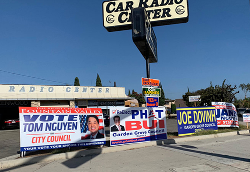 [Caption]In the Orange County neighborhood known as Little Saigon, signs for political candidates with Vietnamese names line an intersection. The states growing Asian-American population is expected to have an impact on the midterms in November.