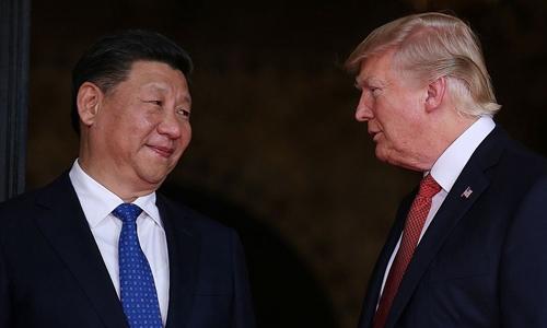 Tổng thống Mỹ Trump (phải) và Chủ tịch Trung Quốc Tập Cận Bình tại Florida hồi tháng 4. Ảnh: Reuters.