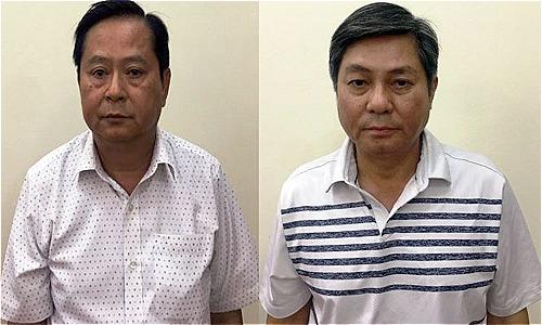 Ông Tín và ông Kiệt từ trái qua bị cơ quan điều tra bắt giữ.