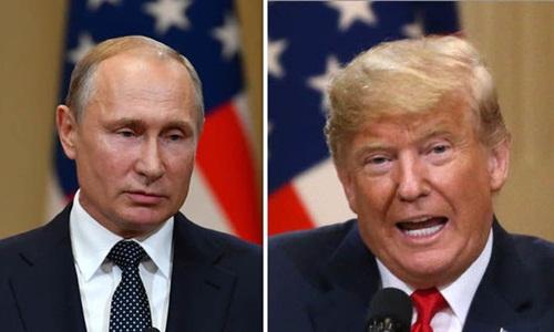 Tổng thống Nga Vladimir Putin (trái) và Tổng thống Mỹ Donald Trump. Ảnh: Express.
