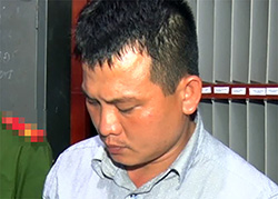 Lê Minh Luân tại cơ quan điều tra. Ảnh: An Bình