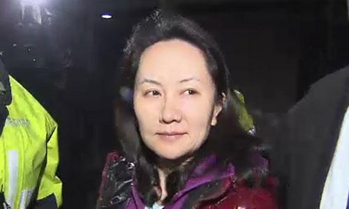 Mạnh Vãn Chu sau khi được tại ngoại ở Vancouver, Canada. Ảnh: AFP.