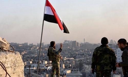 Quân đội Syria tiếp quản thành phố chiến lược từ dân quân người Kurd - ảnh 1