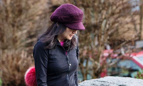 Mạnh Vãn Chu rời nhà riêng ở Vancouver hôm 10/1. Ảnh: Bloomberg.