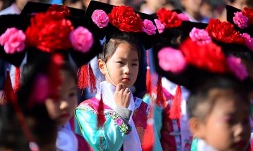 Học sinh Trung Quốc sẽ làm quen với chứng khoán từ tiểu học -