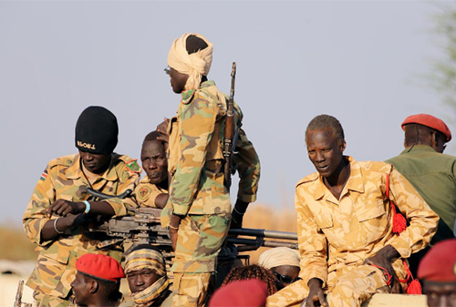 FILE PHOTO: Armed members of the South Sudanese security forces are seen during a ceremony marking the restarting of crude oil pumping at the Unity oil fields in South Sudan, January 21, 2019. REUTERS/Samir Bol/File Photo