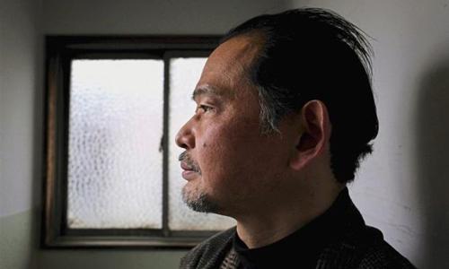 Ikeida, 55 tuổi, một hikikomori sống xa lánh xã hội hơn 20 năm nay ở Tokyo, chụp ảnh hồi tháng 3/2018. Ảnh: AFP.