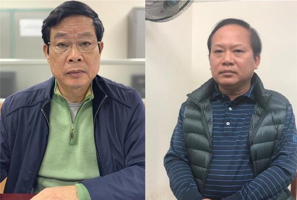 Ông Nguyễn Bắc Son và ông Trương Minh Tuấn tại cơ quan điều tra. Ảnh: Bộ Công an