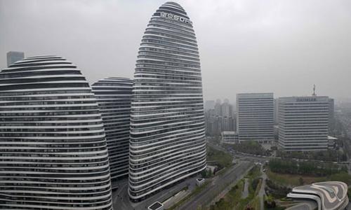 Khu phức hợp ba tòa nhà Wangjing Soho tại Bắc Kinh. Ảnh: AFP.
