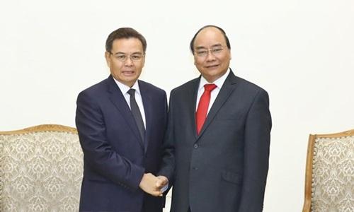 Thủ tướng Nguyễn Xuân Phúc tiếp Ủy viên Bộ Chính trị, Chủ tịch Ủy ban Trung ương Mặt trận Lào Saysomphone Phomvihane. Ảnh: TTXVN.