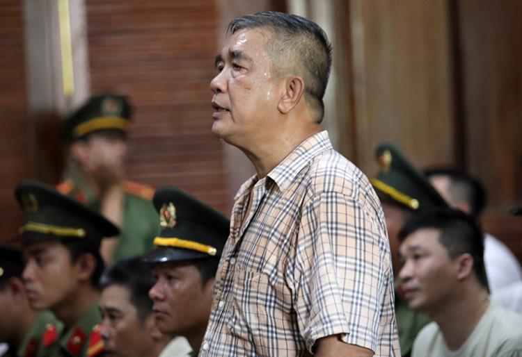 Ông Văn Trọng Thái trả lời tòa chiều nay, về việc mang 4 tỷ đồng đưa cho con trai. Ảnh: Thành Nguyễn.