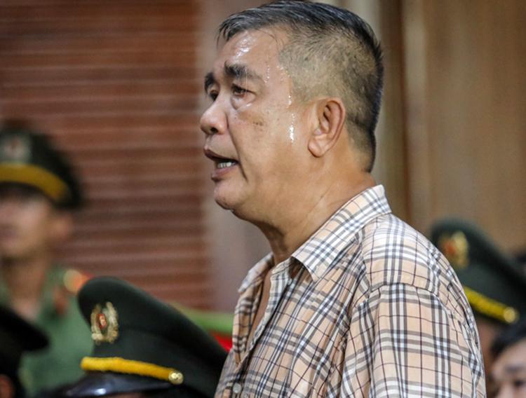 Ông Thái trả lời thẩm vấn của tòa. Ảnh: Thành Nguyễn.