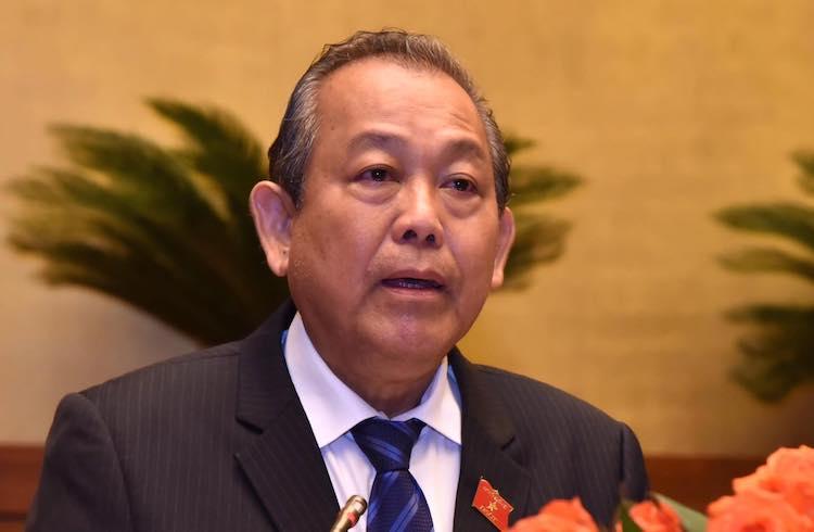 Phó thủ tướng Trương Hoà Bình báo cáo trước Quốc hội sáng 20/5. Ảnh: Hoàng Phong