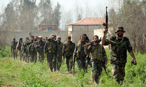 Một nhóm tay súng Hezbollah tham chiến tại Syria năm 2016. Ảnh: AFP.