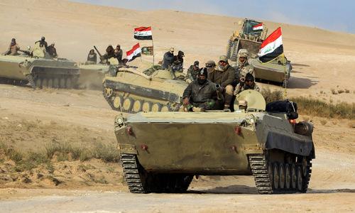Binh sĩ quân đội Iraq và PMF trong chiến dịch tấn công IS cuối năm 2017. Ảnh: AFP.