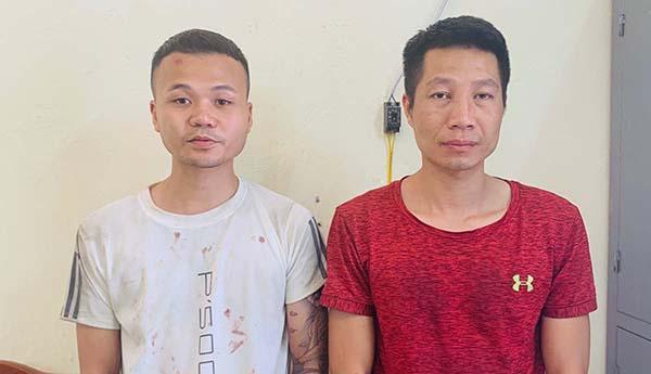 Hai nghi can Nguyễn Đoan Út (trái) và Lê Ngọc Trang tại cơ quan công an. Ảnh: Lam Sơn.