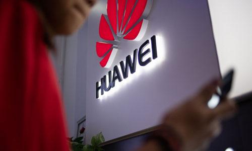 Logo của Huawei tại một cửa hàng tại Bắc Kinh. Ảnh: AFP.