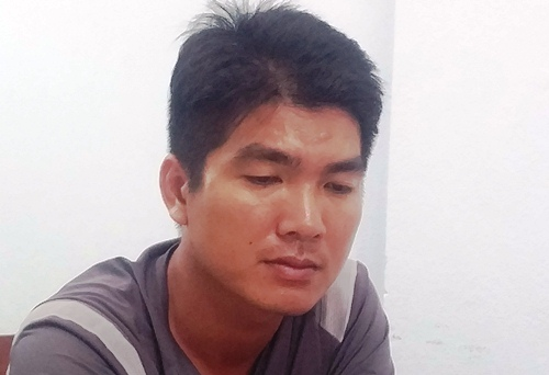 Trần Minh Phông ở cơ quan công an. Ảnh: Thạch Thảo.