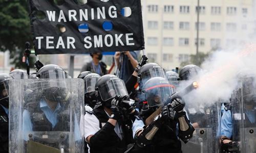 Lý do chính quyền Hong Kong cứng rắn trước dự luật dẫn độ - ảnh 1