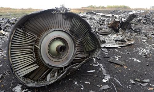 Mảnh vỡ của máy bay MH17 rơi ở đông Ukraine vào tháng 7/2014. Ảnh: AFP.