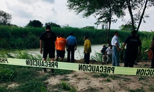 Cái chết của cha con người di cư thổi bùng tranh cãi ở Mỹ - ảnh 1