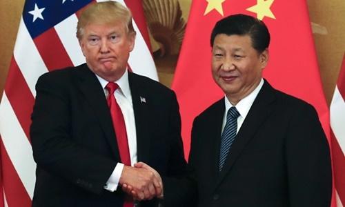Tổng thống Mỹ Trump (trái) và Chủ tịch Trung Quốc Tập Cận Bình tại Bắc Kinh năm 2017. Ảnh: Reuters.