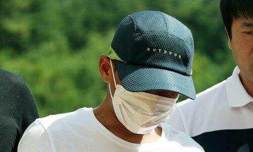 Người chồng Hàn Quốc bị cảnh sát bắt hôm 8/7. Ảnh: Yonhap.