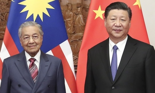 Thủ tướng Malaysia Mahathir Bin Mohamad (trái) và Chủ tịch Trung Quốc Tập Cận Bình tại Bắc Kinh hồi tháng 8. Ảnh: Xinhua.