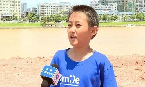 Bé Zhang Yangzhe trả lời phỏng vấn về phát hiện. Ảnh: China Daily.