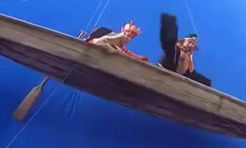 Đường Tăng và Trư Bát Giới trong một cảnh chèo thuyền.