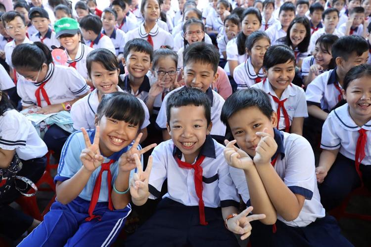 Học sinh trường Tiểu học Lê Văn Thọ, quận Gò Vấp, TP HCM trong lễ khai giảng. Ảnh: Hữu Khoa.