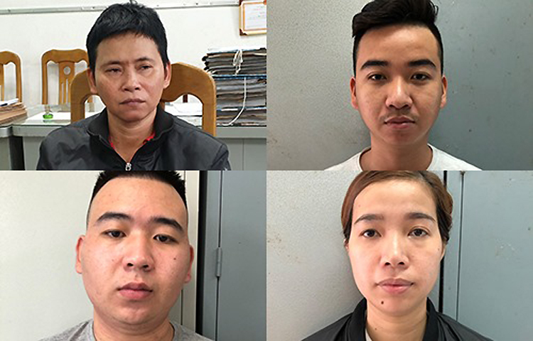 Nguyễn Thị Giàu (bên trái, áo đen) và những bị can tại cơ quan điều tra. Ảnh: Quốc Thắng.