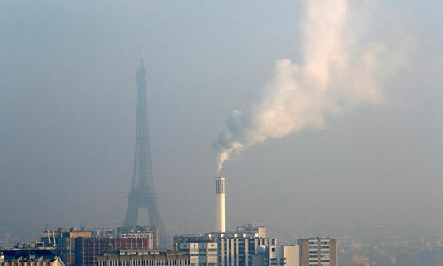 A view from the AirParif Generali balloon shows the Eiffel Tower through a small-particle haze as air pollution levels rise in Paris on January 23. A French woman is suing Paris over air pollution, according to reports on June 7.