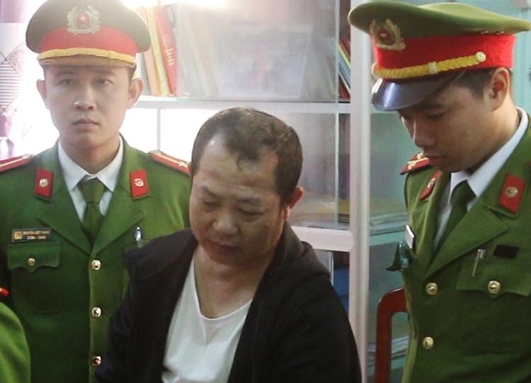 Ông Đức nghe lệnh bắt tạm giam. Ảnh: Ngô Quang Văn