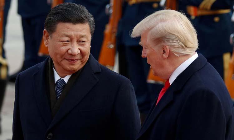 Chủ tịch Trung Quốc Tập Cận Bình (trái) và Tổng thống Mỹ Donald Trump tại Bắc Kinh hồi tháng 11/2017. Ảnh: Reuters.