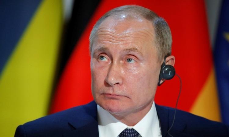 Putin chỉ trích lệnh cấm Nga dự World Cup, Olympic - ảnh 1