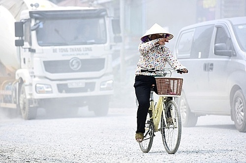 Khói bụi từ giao thông và công trình xây dựng trên đường phố Hà Nội. Ảnh:Giang Huy