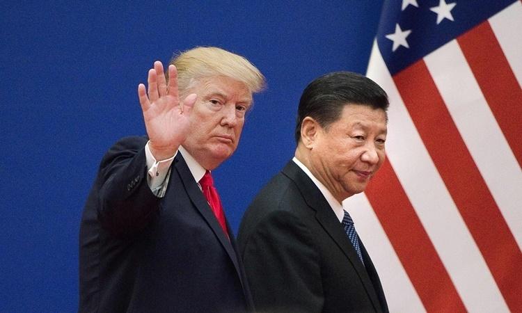 Tổng thống Mỹ Donald Trump và Chủ tịch Trung Quốc Tập Cận Bình tại cuộc gặp ở Bắc Kinh hồi tháng 11/2017. Ảnh: AFP.
