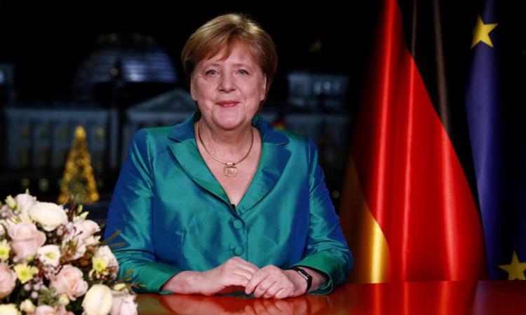 Thủ tướng Đức Angela Merkel trong thông điệp năm mới được phát đi ngày 31/12. Ảnh: Reuters.