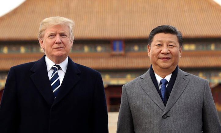 Tổng thống Mỹ Donald Trump (trái) và Chủ tịch Trung Quốc Tập Cận Bình tại Bắc Kinh hồi tháng 11/2017. Ảnh: AP.