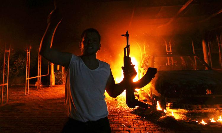 Một tay súng tham gia cuộc tấn công đêm 11/9/2012. Ảnh: Reuters.