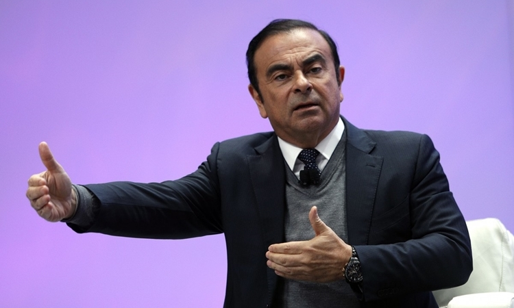 Cựu chủ tịch Nissan Carlos Ghosn phát biểu tại Triển lãm ôtô quốc tế ở Detroit, Michigan, Mỹ, hồi tháng 1/2017. Ảnh: AFP.