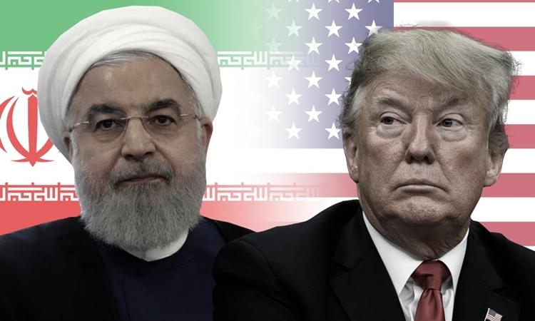 Tổng thống Trump (phải) và Tổng thống Iran Hassan Rouhani. Ảnh: TNS.