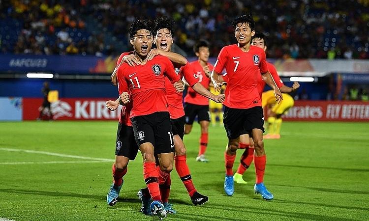 Dong-jun (số 11)chia vui cùng đồng đội. Ảnh: AFC.