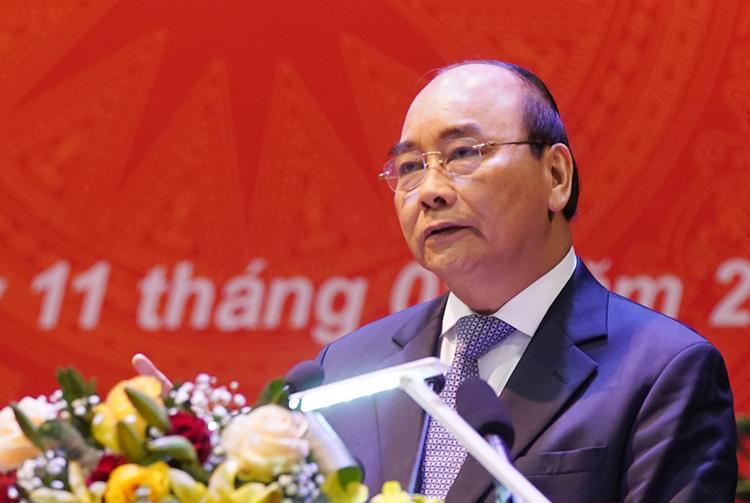 Thủ tướng Nguyễn Xuân Phúc phát biểu sáng 11/1. Ảnh: VGP