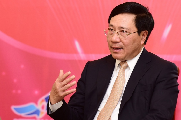 Phó thủ tướng Phạm Bình Minh trong cuộc gặp báo chí cuối năm vào ngày 14/1 tại Hà Nội. Ảnh: Giang Huy.